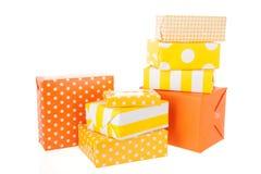 Regalos amarillos y anaranjados Imagen de archivo libre de regalías