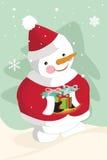 Regalos de la Navidad del muñeco de nieve que llevan Foto de archivo