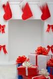 Regalos de la Navidad por la chimenea Fotografía de archivo libre de regalías