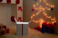 Regalos de la Navidad por la chimenea y el abeto Imagenes de archivo