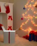 Regalos de la Navidad por la chimenea y el abeto Fotos de archivo libres de regalías