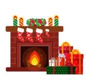 Regalos de Navidad debajo de la chimenea fotos de archivo libres de regalías
