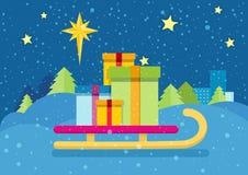 Regalos de Navidad en el trineo Fondo Nevado Foto de archivo libre de regalías