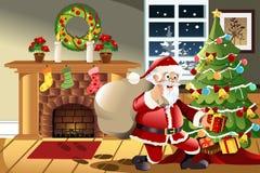 Regalos de Navidad que llevan de Papá Noel Fotografía de archivo