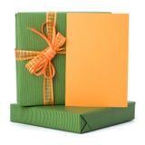 Regalos de Pascua con la tarjeta de felicitación imágenes de archivo libres de regalías