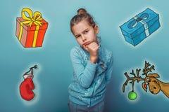 Regalos de pensamiento adolescentes de los ciervos del bosquejo de la muchacha de la Navidad Imagenes de archivo