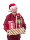 Regalos felices sonrientes de la Navidad del cojinete del hombre mayor Imagenes de archivo
