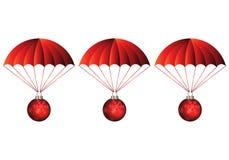 Regalos que llegan de los paracaídas rojos fotos de archivo