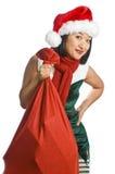 Regalos que llevan del duende de la Navidad Imagen de archivo