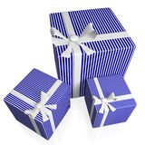 Regalos rayados azules con las cintas blancas del arco Fotografía de archivo libre de regalías