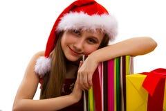 Regalos y pequeña muchacha Papá Noel de la Navidad fotos de archivo libres de regalías