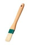 Regando a escova com um punho de madeira isolado Fotos de Stock Royalty Free
