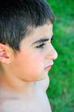 Regard de profil d'un garçon Photographie stock libre de droits