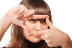 Regard fixe attentif par la trame de doigt Image libre de droits