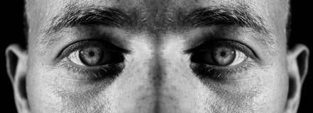 Regard fixe mauvais de yeux Photos stock