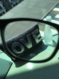 Regard par les verres pour l'amour Photographie stock