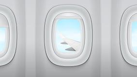 Regardant dans la fenêtre sur Wing Of An Airplane, ciel nuageux bleu illustration libre de droits