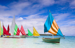 Regatta. Preparation for start of a sailing regatta in Mauritius. Colorful traditional Mauritian wooden boats called Pirogue Royalty Free Stock Images
