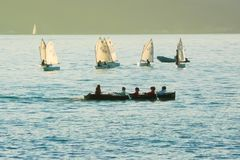Regatta in the bay of Lerici at sunset Italy stock photo