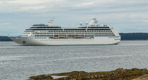 Regatta Cruise Ship. The cruise ship Regatta from Oceania Cruises docked just off shore of Bar Harbor, Maine Royalty Free Stock Photo