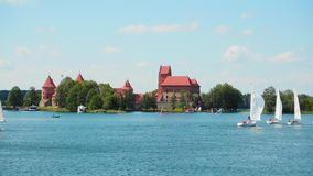 Regatta on the lake near Trakai Castle, , JUNE 18, 2016 in Trakai, Lithuania. Trakai, Lithuania - JUNE 18, 2016: Regatta on the lake near Trakai Castle, , JUNE stock footage