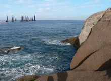 Regatta in the Sea with Rocks Stock Images