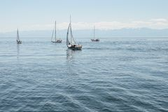 Sailboats is sailing away to the ocean stock photos