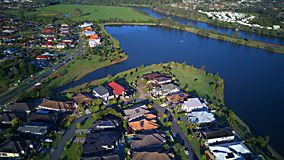 Regatta Waters On The lake and Parkland Gold Coast Grass play area House Estate next to Coomera River On The lake, stock images