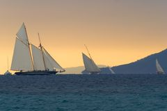 Regattas under  storm. Old sailboats  in Cannes bay during les Regates Royales in September 2008. The weather was stormy with a very strange  light above the Royalty Free Stock Photography