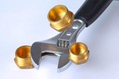 Regelbare moersleutel met drie stoppen stock afbeelding