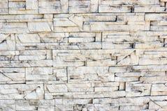 Regelbundet återkommande ljusa stänger för stenmurverk Royaltyfria Bilder