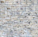 Regelbundet återkommande ljusa stänger för stenmurverk Arkivbild