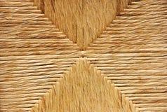 Regelmäßiger Stuhlhintergrund des Strohseils Stockbilder