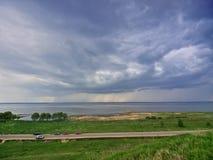 Regen über See Stockbilder