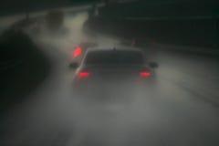 Regen en weg Stock Foto's