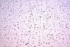 Regen gelaten vallen venster Stock Afbeelding
