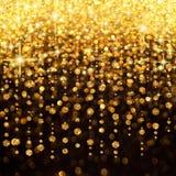 Regen von Leuchte-Weihnachten oder von Party-Hintergrund Stockfotos