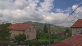 Regen-Wolken über Häusern 01 stock video