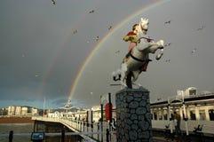 Regenbogen über Brighton Pier, Sussex England Lizenzfreies Stockbild