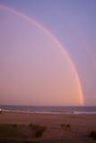Regenbogen über dem Meer nach Sturm Lizenzfreie Stockbilder