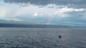 Regenbogen über kleinem Fischerboot im Gewitter stock video footage