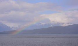 Regenbogen über Schutz-Insel Stockbilder