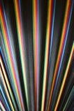 Regenbogen farbige Streifen auf schwarzem Gewebe Stockfotografie
