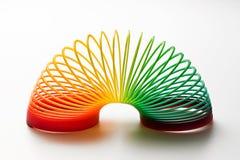 Regenbogen farbiges schleichendes Spielzeug Stockfoto