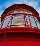 Regenbogen im Leuchtturm-Fenster stockbild