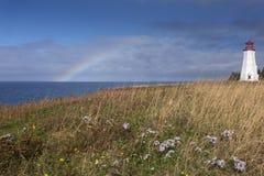 Regenbogen am Seacow-Kopfleuchtturm, Prinz Edward Island Stockbilder