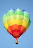 Regenbogen-Streifen-Heißluft-Ballon Stockfotografie