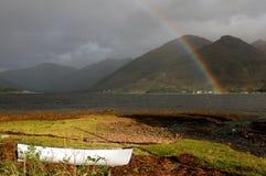 Regenbogen und Boot Stockbilder