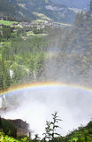 Regenbogen und die Krimml-Wasserfälle, Österreich Stockbild