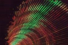 Regenbogen von farbigen Lichtern in einem Bogen Stockbilder